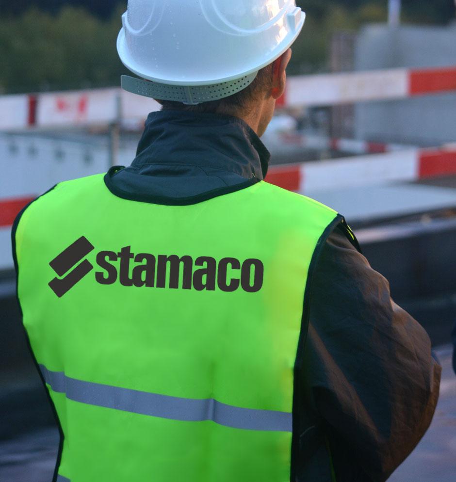 potisk reflexních vest pro řemeslníky stavební firmy Stamaco, potisk proveden technologií termotransfer flex
